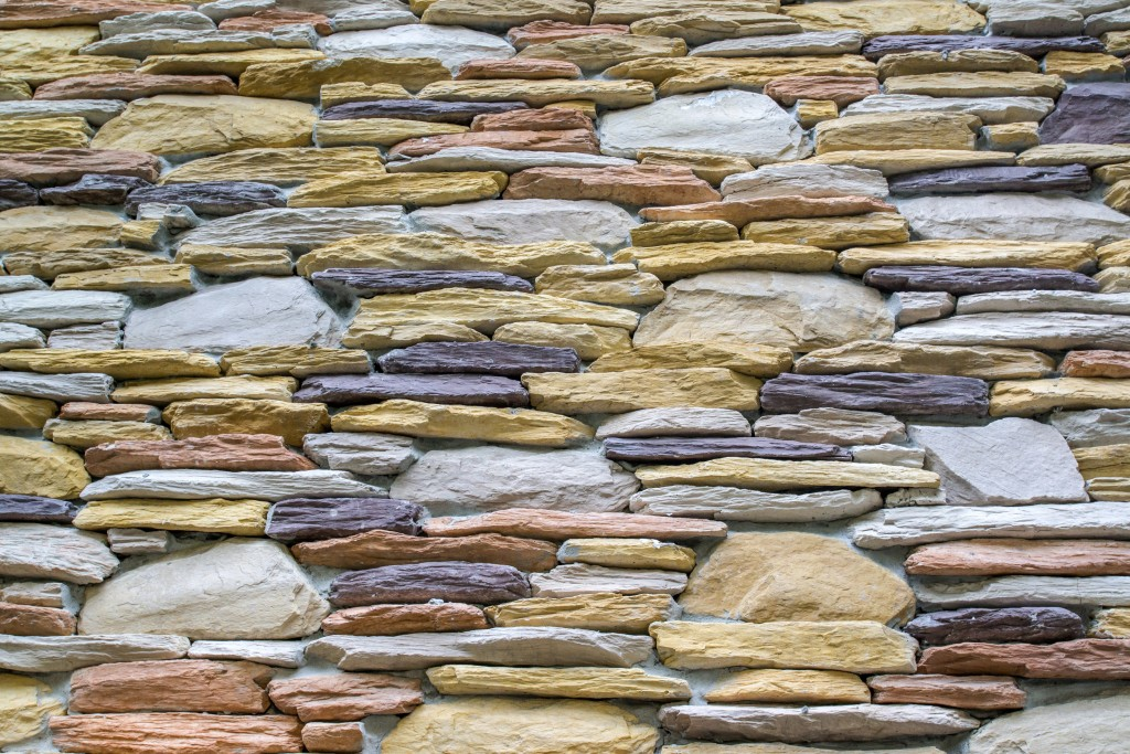 If your home has an exposed foundation, consider covering this eyesore with a more appealing material such as faux stone. This will add a sense of completeness and luxury to your home's curb appeal.