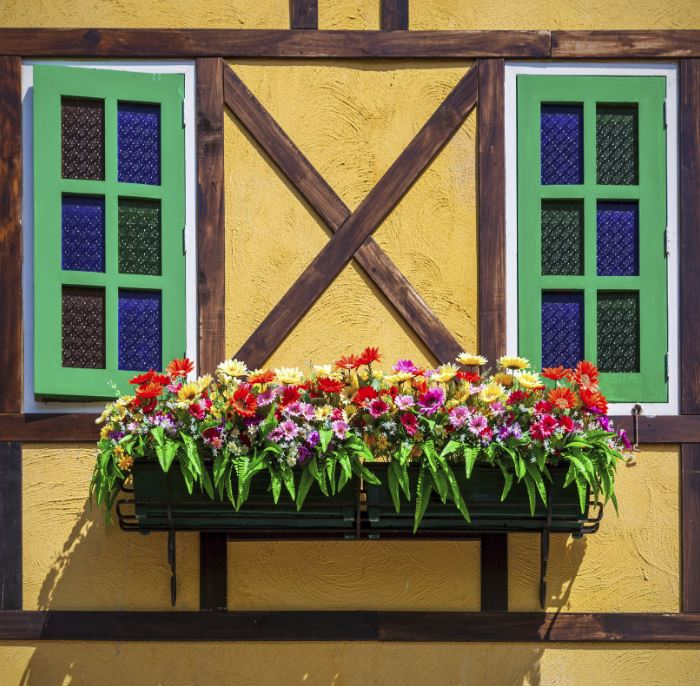 Windows can feel bland or naked when they aren't accented at all. Consider adding shutters, accent trim, and/or window boxes to your home. These changes will draw positive attention to your windows.