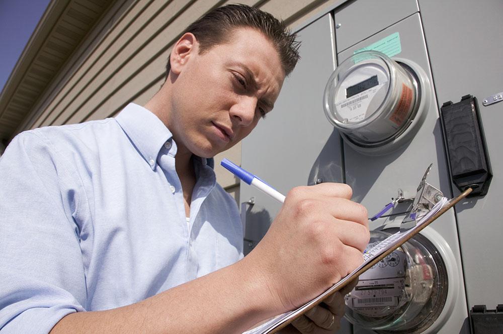 Man reading power meter