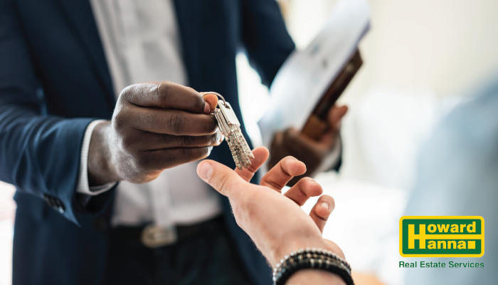 real estate agent handing keys to another person