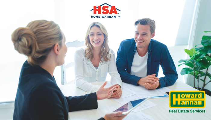 a couple discusses an hsa home warranty with a real estate professional